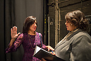 Hempstead, New York, USA. January 1, 2018. Off-stage, Hempstead Town Clerk SYLVIA CABANA and Assemblywoman MICHAELLE SOLANGES who will administer oath, rehearse Swearing-In before ceremony at Hofstra University.