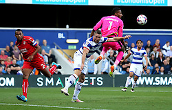 Conor Washington of Queens Park Rangers and Lawrence Vigouroux of Swindon Town clash for the ball - Mandatory by-line: Robbie Stephenson/JMP - 10/08/2016 - FOOTBALL - Loftus Road - London, England - Queens Park Rangers v Swindon Town - EFL League Cup