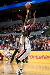 Maryland guard Marah Strickland (5) shoots over Virginia forward Lyndra Littles (1).  The Virginia Cavaliers women's basketball team faced the #4 ranked Maryland Terrapins at the John Paul Jones Arena in Charlottesville, VA on January 18, 2008.