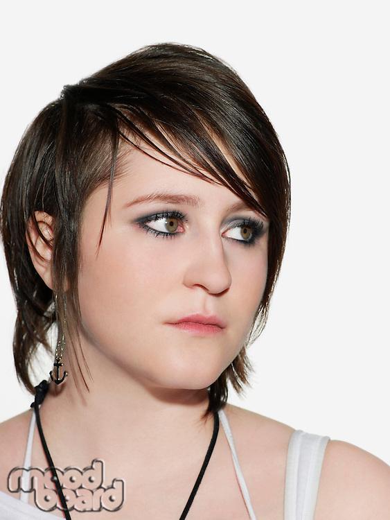Teenage girl (16-17) looking away close-up