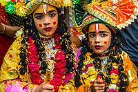 Boys dressed as Lord Krishna, Chhadi Mar Holi (one of the local Holi festivals in the Mathura area), Gokul, Uttar Pradesh, India.