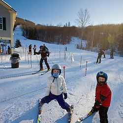 Two young skiers at Jiminy Peak ski resort in the Berkshire Mountains in Hancock, Massachusetts.