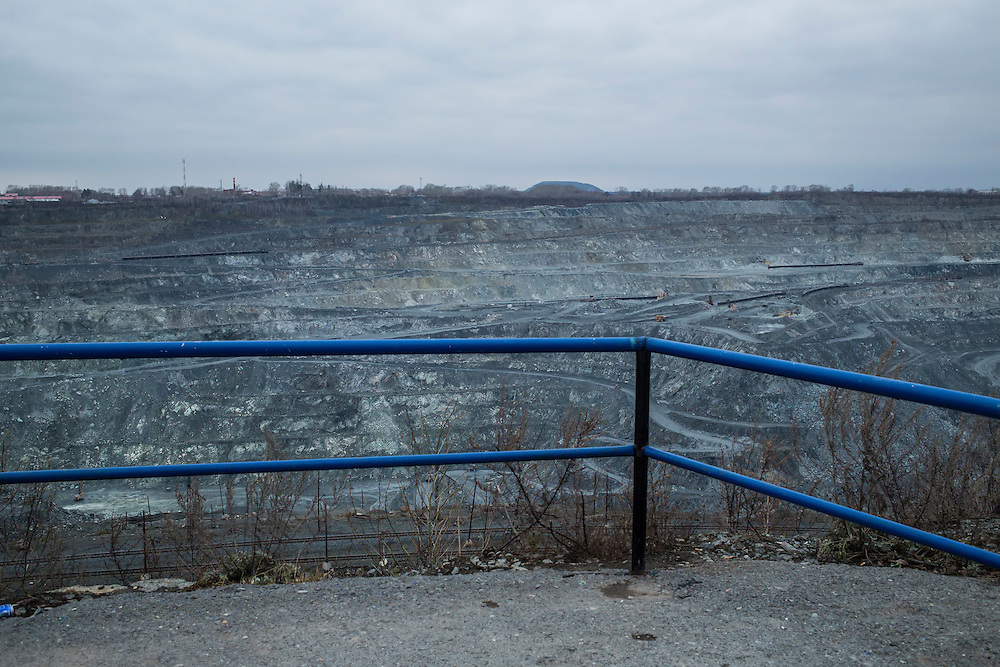 The Uralasbest asbestos mine seen from an observation point on Tuesday, November 12, 2013 in Asbest, Russia. The mine is among the largest producers of the chrysolite form of asbestos in the world.