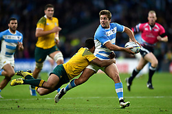 Santiago Cordero of Argentina looks to offload the ball after being tackled by Will Genia of Australia - Mandatory byline: Patrick Khachfe/JMP - 07966 386802 - 25/10/2015 - RUGBY UNION - Twickenham Stadium - London, England - Argentina v Australia - Rugby World Cup 2015 Semi Final.
