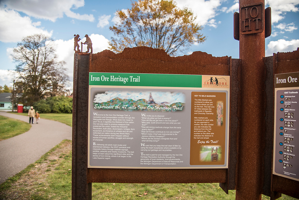 Trail signage and interpretive kiosks in Negaunee, Michigan along the Iron Ore Heritage Trail, a multiuse recreation trail connecting communities in Marquette County on Michigan's Upper Peninsula.
