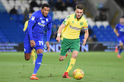 Cardiff City midfielder Nathaniel Mendez-Laing (19) battles with Norwich City defender Ivo Pinto (2) 2-1 during the EFL Sky Bet Championship match between Cardiff City and Norwich City at the Cardiff City Stadium, Cardiff, Wales on 1 December 2017. Photo by Alan Franklin.