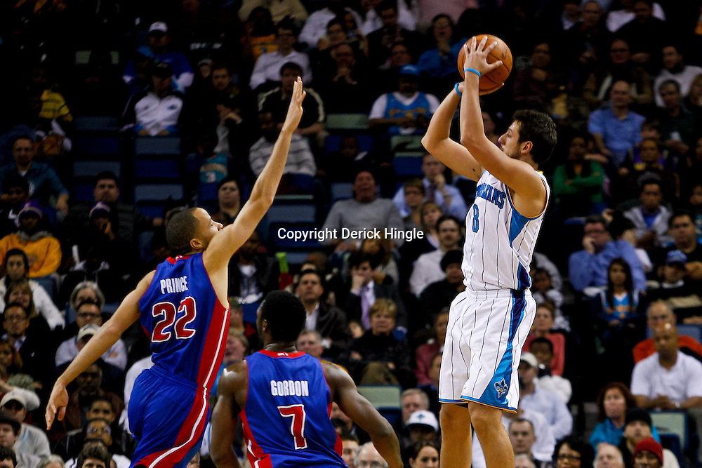 December 8, 2010; New Orleans, LA, USA; New Orleans Hornets shooting guard Marco Belinelli (8) shoots over Detroit Pistons small forward Tayshaun Prince (22) during the first half at the New Orleans Arena. Mandatory Credit: Derick E. Hingle