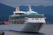 Rhapsody of the Seas cruise ship of Royal Caribbean arriving in Vancouver at dawn.