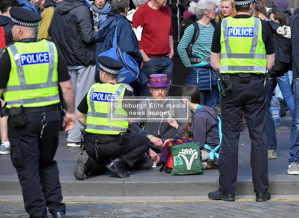 Pictured: A protester get's medical attention after feeling unwell.<br /> <br /> Climate change protesters blocked roads in the city centre including North Bridge, causing severe traffic disruption.<br /> <br /> © Dave Johnston / EEm