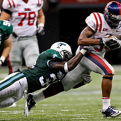 Sep 11, 2010; New Orleans, LA, USA; Tulane Green Wave linebacker Darryl Farley (34) tackles Mississippi Rebels running back Brandon Bolden (34) during a game at the Louisiana Superdome. The Mississippi Rebels defeated the Tulane Green Wave 27-13.  Mandatory Credit: Derick E. Hingle