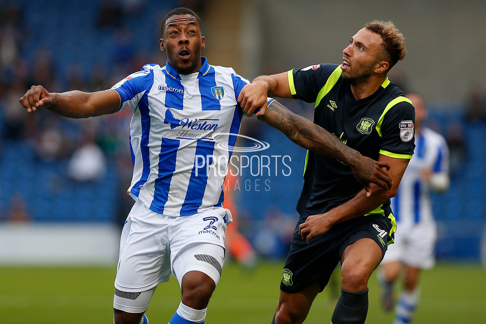 Colchester United's Ryan Jackson(2) Carlisle United's Hallam Hope battles for possession during the EFL Sky Bet League 2 match between Colchester United and Carlisle United at the Weston Homes Community Stadium, Colchester, England on 14 October 2017. Photo by Phil Chaplin