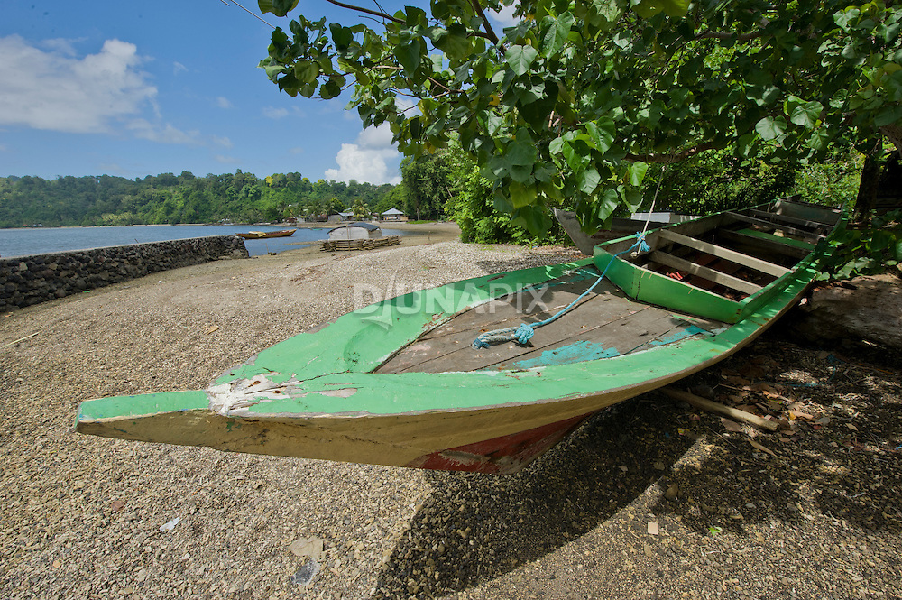 A colorful boat parked along the beach of Banda Besar.