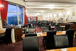 Main diningroom in the Scarborough Grand Hotel, a Grade II listed building Dominating the the town's South Bay. When completed in 1867 it was one of the largest hotels in the world, as well as one of the first giant purpose-built hotels in Europe. The hotel is in the shape of a 'V' in honour of Queen Victoria and was designed around the theme of time: <br /> 4 towers to represent the seasons, <br /> 12 floors for the months of the year, <br /> 52 chimneys symbolise the weeks, <br /> originally there were 365 bedrooms - one for each day of the year. <br /> As Scarborough was a famous 'Spa Town' in its heyday the Grand hotels baths included an extra pair of taps so guests could wash in seawater as well as fresh water.<br /> The hotel was badly damaged when the German Navy bombarded the town in 1914.<br /> Three blue plaques outside mark where the novelist Anne Brontë died in 1849, the contribution of the RAF trainees stationed at the hotel during the Second World War, and the original opening of the building.<br />  12 September 2015<br />  Copyright Paul David Drabble<br />  www.pauldaviddrabble.photoshelter.comom