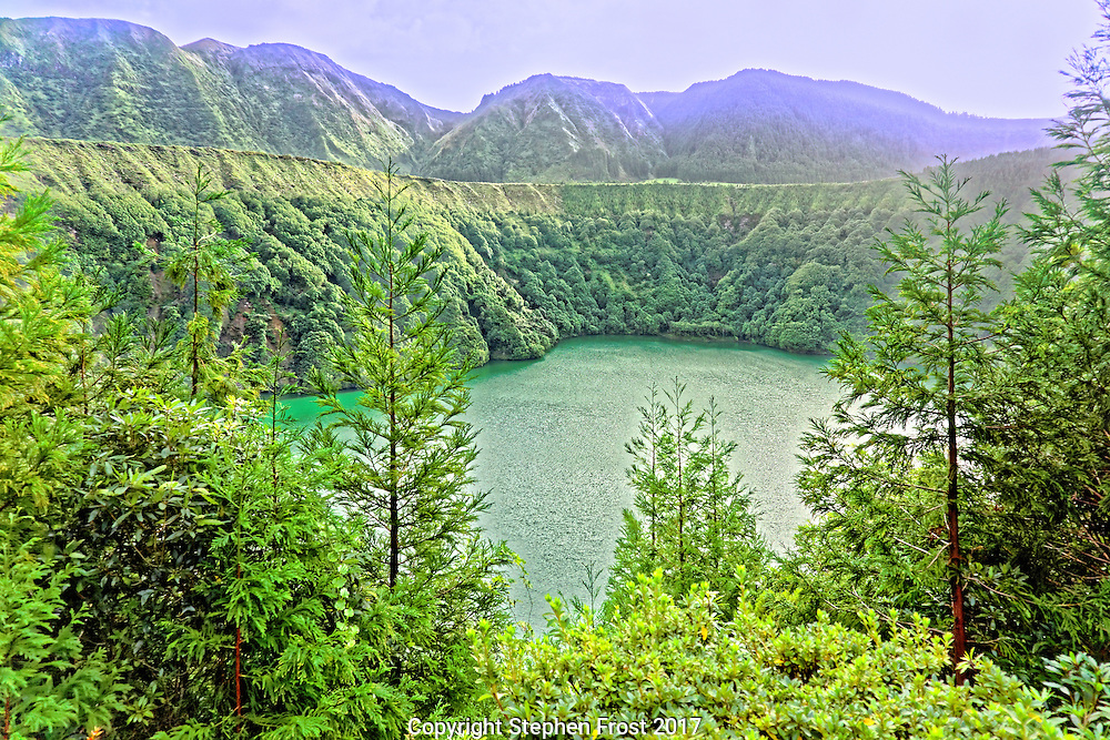A lake in the crater of a dormant volcano, on the Island of  São Miguel in the Portuguese archipelago of the Azores. The area is known locally as Lagoa das Sete Cidades.