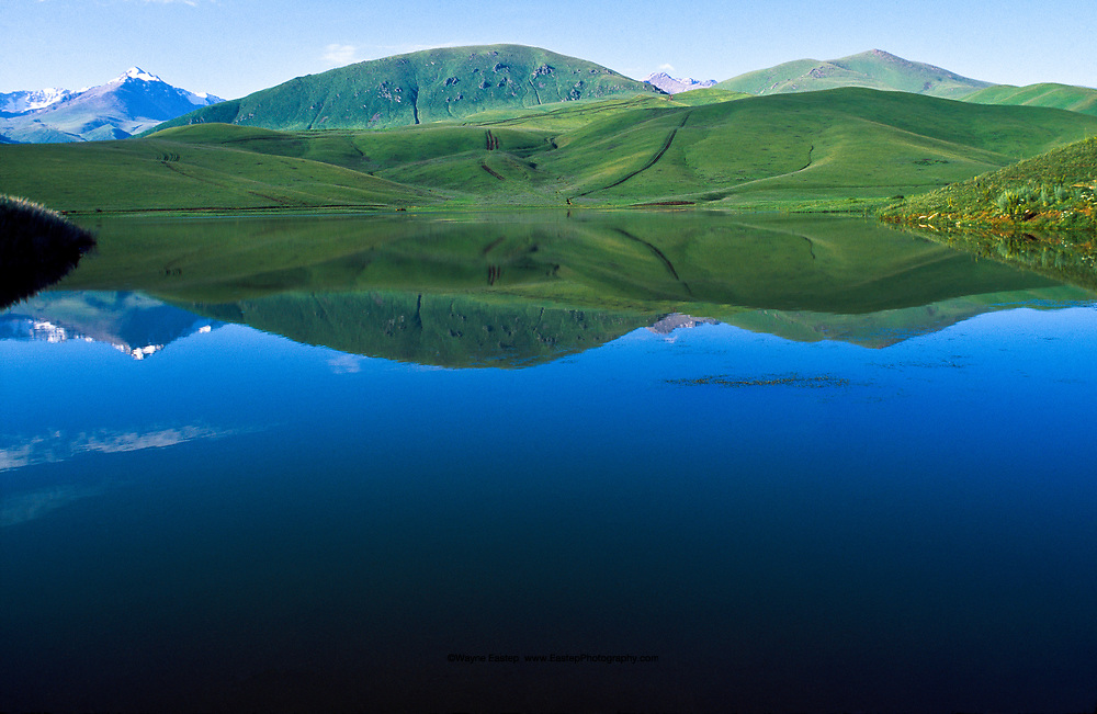Kazakhstan is dotte with 48,000 lakes, many small like this mirror-surfaced one at Ush-Konyr near Fabrichny