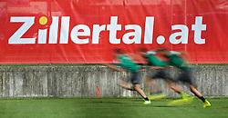 19.07.2014, Parkstadion, Zell am Ziller, AUT, SV Werder Bremen Trainingslager, im Bild Spieler beim Sprint, aufgenommen mit bewusst lang gewählter Belichtungszeit, im Hintergrund eine Zillertal-Bande // during the Preparation Camp of the German Bundesliga Club SV Werder Bremen at the Parkstadion in Zell am Ziller, Austria on 2014/07/19. EXPA Pictures © 2014, PhotoCredit: EXPA/ Andreas Gumz<br /> <br /> *****ATTENTION - OUT of GER*****