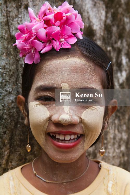 Portrait of girl face painted white, Bagan, Myanmar