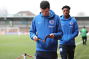 Brighton & Hove Albion winger Jamie Murphy (15) reading the matchday programme before the EFL Sky Bet Championship match between Brentford and Brighton and Hove Albion at Griffin Park, London, England on 5 February 2017.