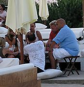 "**EXCLUSIVE**.Boris Becker and wife Lilly Kerssenberg..Nikki Beach Restaurant..St Tropez, France..Wednesday, July 29, 2009..Photo By Celebrityvibe.com.To license this image please call (212) 410 5354; or Email: celebrityvibe@gmail.com ; .website: www.celebrityvibe.com..Boris Becker was at Beautiful Model infested party at a private villa in St Tropez on Wednesday July 29, 09 without his wife Lily Kerssenberg..He had plenty of attention from the beauties, as every 10 minutes a different girl would ask him to be photographed with; he was very friendly to every one..Now that he is not playing tennis he is smoking lots of cigarettes and drinking rose wine all day, his friend even got him a bottle from the bar so he can have his own by his side..His wife came to pick him up but didn't come out of the Chauffer driven car and they went to Nikki Beach where they got a table by the bar..They were kissing each other and he order two rounds of drinks, but she was not drinking. As you can see in these photos she looks pregnant, she was touching her belly and not drinking, these are things the pregnant women usually does..While they were sitting five beautiful girls came to ask Boris for a photo with him and he said yes. They got behind him and posed. As soon as they left Lily started screaming at Boris and telling him that she had enough with all the flirting and said, "" I am tired of it, I had enough"". Then she took her girlfriend's hand and stormed out of the place from the back door, he stayed behind with his buddies drinking but noticeably upset.."