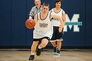 Mount Mansfield's Thomas Caswell (12) dribbles the ball down the court during the unified basketball game between Colchester and Mount Mansfield at MMU High School on Monday afternoon April 25, 2016 in Jericho. (BRIAN JENKINS/for the FREE PRESS)