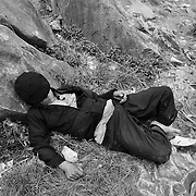 A Hmong man slumps asleep after drinking at an early morning market in Ha Giang, Vietnam's northernmost province, 22 June, 2007. As cities like Hanoi and Ho Chi Minh roar with Vietnam's economic boom, Ha Giang remains a quiet, serene and beautiful mountain backwater along the Chinese border.