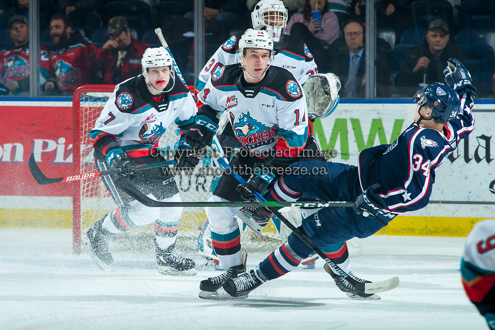 KELOWNA, BC - FEBRUARY 12: Sasha Mutala #34 of the Tri-City Americans collides with Elias Carmichael #14 of the Kelowna Rockets during first period at Prospera Place on February 8, 2020 in Kelowna, Canada. (Photo by Marissa Baecker/Shoot the Breeze)
