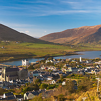 Cahersiveen, County Kerry and Knocknatobar (Cnoc na dTobar) in the background with the Old Railway Bridge, The Old Barracks and the Daniel O'Connell Memorial Church of the Holy Cross