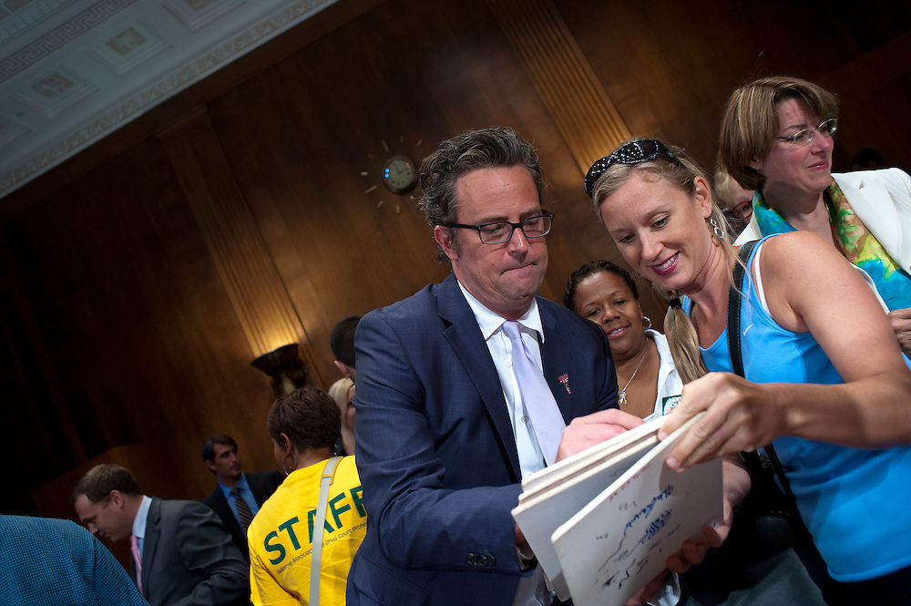 "Actor MATTHEW PERRY signs an autograph following a Senate Judiciary Committee hearing ""Drug and Veterans Treatment Courts: Seeking Cost-Effective Solutions for Protecting Public Safety and Reducing Recidivism."""