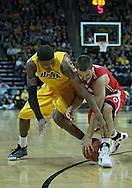 January 07, 2011: Iowa Hawkeyes guard/forward Roy Devyn Marble (4) and Ohio State Buckeyes guard Aaron Craft (4) battle for the ball during the the NCAA basketball game between the Ohio State Buckeyes and the Iowa Hawkeyes at Carver-Hawkeye Arena in Iowa City, Iowa on Saturday, January 7, 2012.