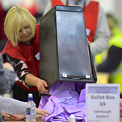 SCOTTISH PARLIAMENTARY ELECTION 2016 – Counting Agents emptying ballot boxes during the vote counting at  the Royal Highland Centre, Edinburgh<br />(c) Brian Anderson | Edinburgh Elite media