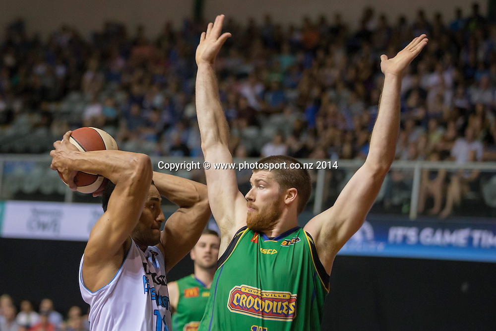 Crocodiles' Brian Conklin challenges Breakers` Mika Vukona in the game between SkyCity Breakers v Townsville Crocodiles. 2014/15 ANBL Basketball Season. North Shore Events Centre, Auckland, New Zealand, Friday, December 19, 2014. Photo: David Rowland/Photosport