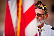 "15 JANUARY 2012 - PHOENIX, AZ:    A member of the VFW stands with a flag waiting for returing soldiers at the The 161st Air Refueling Wing of the Arizona Air National Guard in Phoenix. About 100 soldiers of A (Alpha) Company of the 422nd Expeditionary Signal Battalion (referred to as ""Alpha 4-2-2"") of the Arizona Army National Guard returned to Arizona on Sunday, Jan. 15, following a nearly year-long deployment to Afghanistan. More than 10,000 Arizona Army and Air National Guard Soldiers and Airmen have been ordered to federal active duty in support of Operations Noble Eagle, Enduring Freedom, Iraqi Freedom, and New Dawn since September 2001. Approximately 200 Arizona National Guard Soldiers and Airmen are still serving on federal active duty overseas. PHOTO BY JACK KURTZ"
