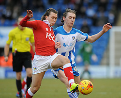 Bristol City's Luke Freeman jostles for the ball with Colchester United's Elliott Hewitt - Photo mandatory by-line: Dougie Allward/JMP - Mobile: 07966 386802 - 21/02/2015 - SPORT - Football - Colchester - Colchester Community Stadium - Colchester United v Bristol City - Sky Bet League One