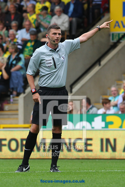 Picture by Paul Chesterton/Focus Images Ltd +44 7904 640267<br /> 17/08/2013<br /> Referee Michael Oliver during the Barclays Premier League match at Carrow Road, Norwich.