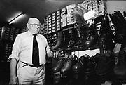Mr Holt in Holts Dr Martens Shop, Camden, London, UK, 1980s.