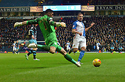 Sheffield Wednesday Goalkeeper, Keiren Westwood clears the ball from an advancing Blackburn Rovers Forward, Jordan Rhodes during the Sky Bet Championship match between Blackburn Rovers and Sheffield Wednesday at Ewood Park, Blackburn, England on 28 November 2015. Photo by Mark Pollitt.