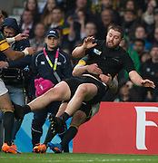 Twickenham. Great Britain, No.2's tangle, Dane CO:ES is taken out of the field of play by Bismack DU PLESSIS,  during, Semi Final. South Africa vs New Zealand  2015 Rugby World Cup,  Venue, Twickenham Stadium, Surrey England.   Saturday  24/10/2015.   [Mandatory Credit; Peter Spurrier/Intersport-images]