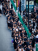 26 OCTOBER 2017 - BANGKOK, THAILAND:  People line up in front of a mall in Bangkok to make an offering for the late king during the funeral ceremony for Bhumibol Adulyadej, the Late King of Thailand. The king died on 13 October 2016 and was cremated 26 October 2017, after a mourning period of just over one year. The revered monarch was the longest reigning king in Thai history and is credited with guiding Thailand through the turbulent latter half of the 20th century.       PHOTO BY JACK KURTZ
