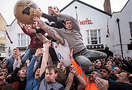 "Atherstone, Warwickshire, UK. 5th March 2019. Pictured:  The ball is thrown out of a first floor window of Barclays Bank into the waiting crowd. / Hundreds of people of all ages flood into the Warwickshire town of Atherstone to either participate or watch the 820th Atherstone Ball Game. The Atherstone Ball Game is an ancient Shrove Tuesday tradition in which the people of this rural North Warwickshire town awaken and literally brawl over a large ball up and down the town's small ancient streets. Shops are boarded up, local schools are closed and town people of Atherstone gather in the main street at 3pm with only one rule in mind, the ball cannot be taken outside the town. Anything and everything else goes. The winner in this no holds barred contest is the person holding onto the ball at 5pm. This traditional Shrove Tuesday Ball Game has been held annually since the early 12th Century and is one of Atherstone's claims to fame. The origin of the game, in the reign of King John, is thought to have been a ""Match of Gold that was played between the Warwickshire Lads and the Leicestershire Lads on Shrove Tuesday"".  // Lee Thomas, Tel. 07784142973. Email: leepthomas@gmail.com  www.leept.co.uk (0000635435)"