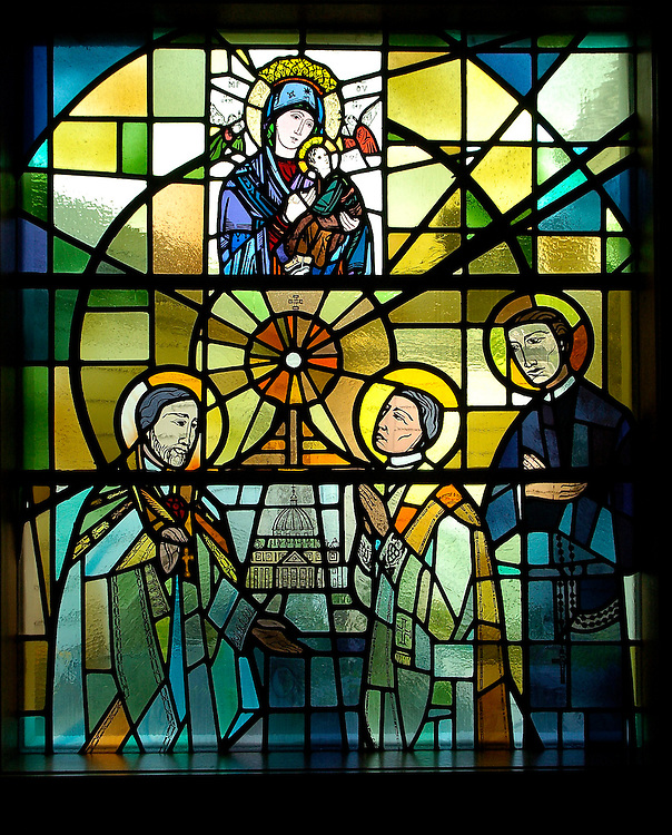 A stained glass window inside of the Redemptorist Retreat Center chapel depicts the religious order's founder, St. Alphonsus Ligouri, with two of his followers. Above them is an image of Our Lady of Perpetual Help, to whom the Redemptorists have a special devotion. The retreat center, just south of Oconomowoc, is operated by the Redemptorist religious order. (Catholic Herald photo by Sam Lucero)
