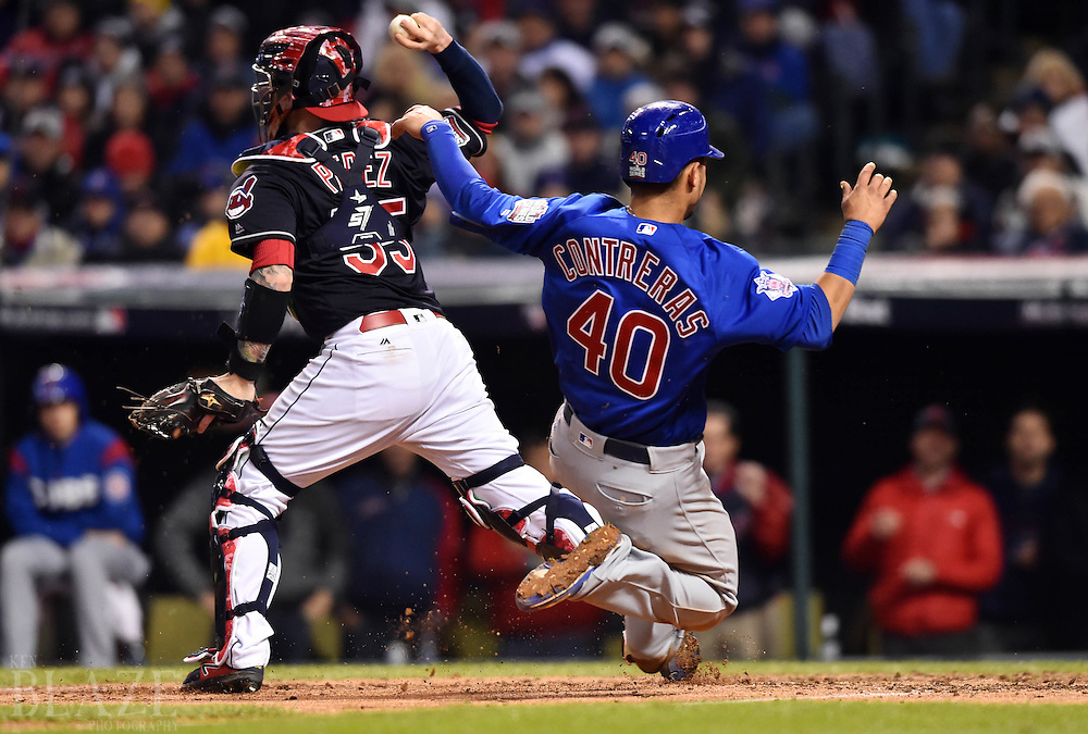 Oct 26, 2016; Cleveland, OH, USA; Chicago Cubs catcher Willson Contreras (40) is forced out at home by Cleveland Indians catcher Roberto Perez (55) in the 7th inning in game two of the 2016 World Series at Progressive Field. Mandatory Credit: Ken Blaze-USA TODAY Sports