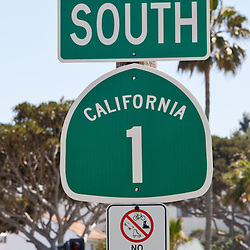 Photo of street sign for South Pacific Coast Highway (PCH) in Laguna Beach California. PCH is also known as State Route 1 (SR 1) and Highway 1 and is a famous scenic road that runs along the Pacific Ocean along California's West Coast.
