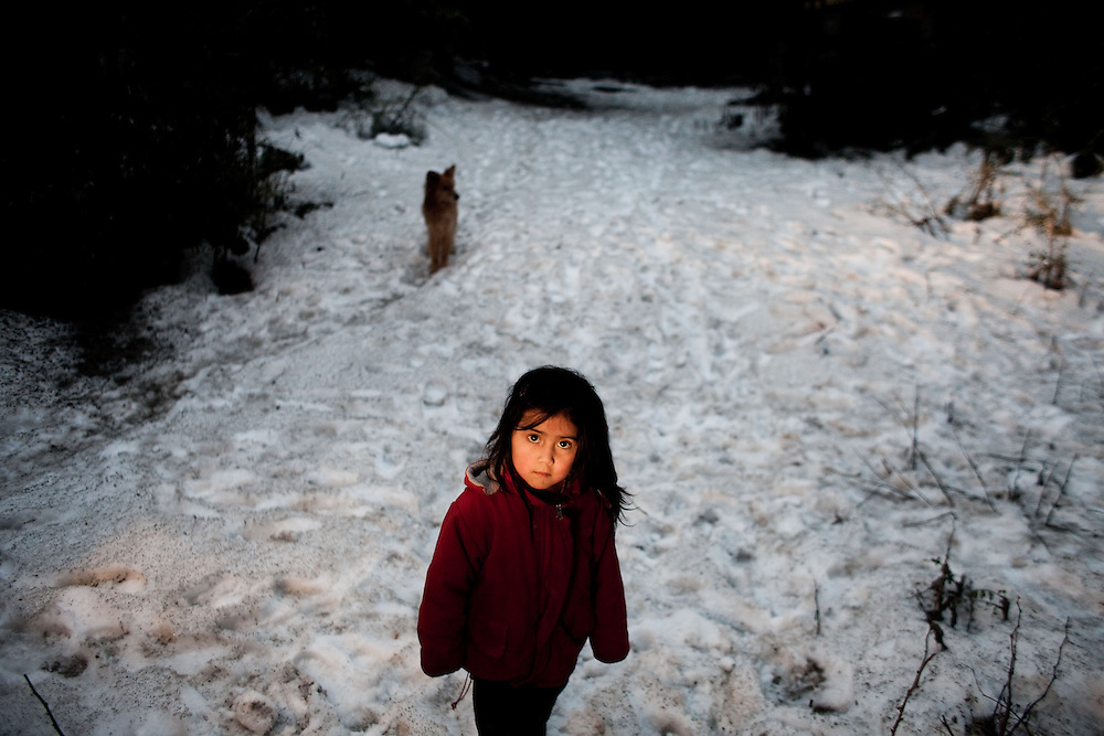 Brisa Torrez, 4, walks back to a moving truck after picking up some belongings from her family's home, which is deep in the woods. Due to June 4ths Volcano Puyehue's eruption, their home's ceiling caved in and tore the house apart. They were evacuated immediately into a public school. They waited approximately 3 months for the municipal to repair the damaged home.