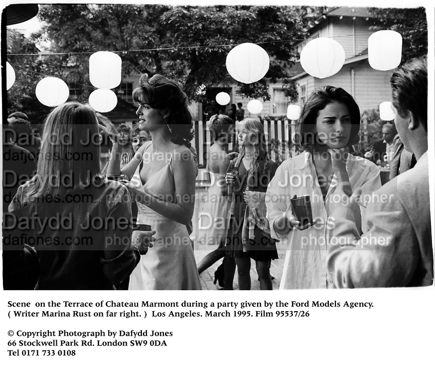 Scene  on the Terrace of Chateau Marmont during a party given by the Ford Models Agency. ( Writer Marina Rust on far right. )  Los Angeles. March 1995. Film 95537/26<br />