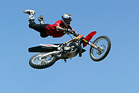 Jul 01, 2003; Anaheim, California, USA; Moto X star athlete MIKE METZGER executing a tremendous stunt feet free with a full sized motobike at the opening of Disney's California Adventure &quot;X Games Experience&quot;.  Disney park has built two X-Arena's specifically for this 41 day event highlighting extreme sports for the launch of the 2003 ESPN X Games.<br />