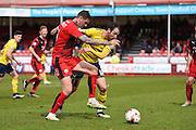 Oxford forward Danny Hylton and Crawley Town Defender Sonny Bradley during the Sky Bet League 2 match between Crawley Town and Oxford United at the Checkatrade.com Stadium, Crawley, England on 9 April 2016. Photo by David Charbit.