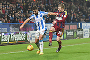 Huddersfield Town defender Tommy Smith (2) and Freddie Sears (20) Ipswich Town during the EFL Sky Bet Championship match between Huddersfield Town and Ipswich Town at the John Smiths Stadium, Huddersfield, England on 21 January 2017. Photo by Ian Lyall.