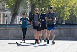 © Licensed to London News Pictures. 05/05/2018. London, UK. A grou of people jogging during hot and sunny weather near the River Thames in London this morning. Photo credit: Vickie Flores/LNP