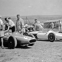 #8 LDS Alfa entered by George Mennie, driven by Fanie Viljoen. Fanie is wearing the floppy hat. At the back the #6 LDS Alfa driven by Doug Serrurier. Doug is in the coveralls looking at Fanie's car, #8, at 1962 Rand Autumn Trophy, Kyalami, South Africa (Fanie died in SA in 2010)