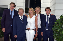 SIR DAVID & LADY CARINA FROST with their sons, left to right, WILFRED FROST, GEORGE FROST and MILES FROST at Sir David & Lady Carina Frost's annual summer party held in Carlyle Square, Chelsea, London on 5th July 2006.<br />